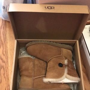 Ugg boots with side button.